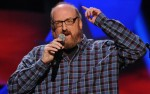 NASHVILLE, TN - FEBRUARY 21:  Comedian Brian Posehn performs as part of CMT Presents Ron White's Comedy Saltue To The Troops at The Grand Ole Opry on February 21, 2012 in Nashville, Tennessee.  (Photo by Rick Diamond/Getty Images for CMT)